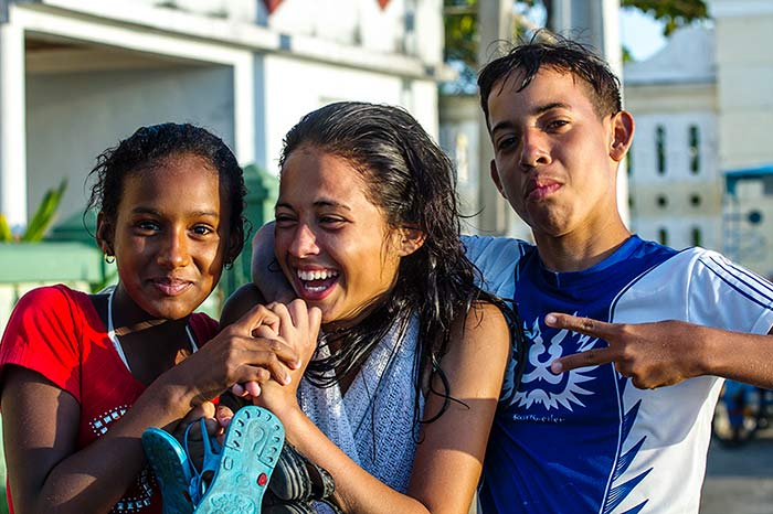 Cuban high school students laughing.